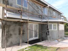stucco or render is a material what to know about buying painting