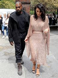 kim kardashian and kanye west wear fall ready boots in may