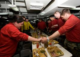 file us navy 101125 n 9626y 083 sailors give thanks before