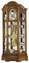 Curio Cabinets Under 200 00 Howard Miller 610 940 Majestic Oak Cable Driven Curio Grandfather