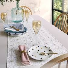 gold christmas table runner nordic star christmas table runner in a gold coloured print la