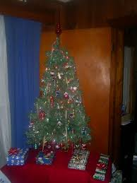 file a small artificial tree with presents jpg