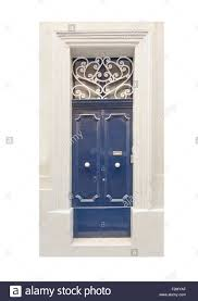 Door Pattern Blue Painted Door With White Wrought Iron Pattern And White Knobs