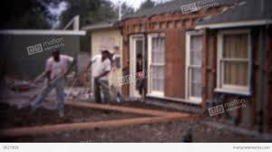 1966 home remodeling backyard workers shovel dirt digging