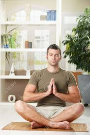 man doing yoga exercise at home sitting on floor in living room