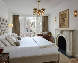a mid century palace on the upper east side decor aid serene neutral bedroom statement light fixture