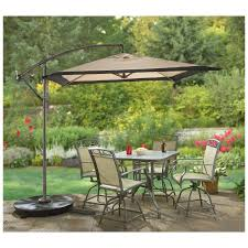 Patio Furniture Set With Umbrella by Square Offset Patio Umbrella Over Patio Table And Chairs Set And