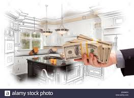 Sketch Kitchen Design by Hand Holding Stacks Of Money Over Custom Kitchen Design Drawing