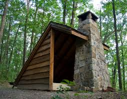 exceptional adirondack lean to with field stone backyard