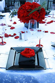 arrangements of giant red roses made elegant table centerpieces