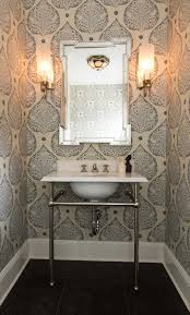 small powder room with wallpaper and wall sconces ways to