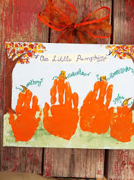 fall pumpkin handprint craft for write their names and ages