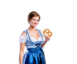 beautiful young woman in traditional bavarian dress holding