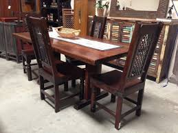 elegant solid wood dining table have 2 solid wood dining chairs