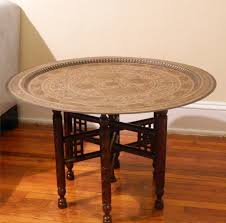 round moroccan hammered brass tray table 300 00 via etsy