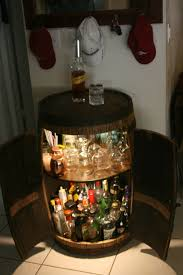 another whiskey barrel cabinet with double doors and automatic
