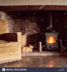 wood burning stove in inglenook fireplace stock photo royalty