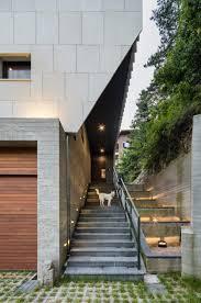 mountainside house plans stone fins cover slanted walls of mountainside house near seoul