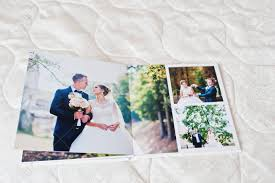 wedding album pages pages of wedding photobook or wedding album on white sofa
