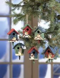 decorating bird houses with scrapbook paper altered
