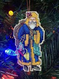 handmade cross stitch ornament penguin in santa claus