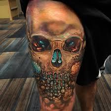 amazing arty skull thigh tattoo best tattoo design ideas