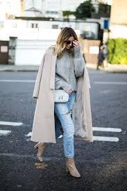 emma hill wears beige swing coat grey fluffy sweater light wash