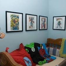 nursery superhero bedroom ideas with wall pictures and decals