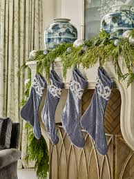 day 12 festive holiday mantels traditional home luxe textural stockings in peaceful blue tones look especially elegant when paired with cascading cedar boughs and ornaments in a similar colorway
