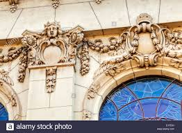 facade on classical building with ornaments and sculptures