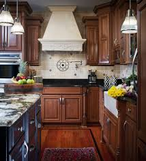exotic granite kitchen transitional with white mounted pot fillers