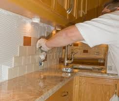 kitchen backsplash tile installation ceramic tile installation on kitchen backsplash 12 stock photo