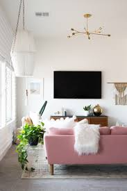 Pink Living Room by A Chic Living Room Update With A Gorgeous Pink Sofa