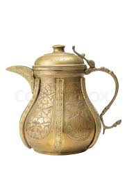 ancient ornamental teapot jug on white background stock photo