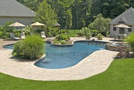 awesome pool shaped and floortile plus deck chairs under umbrella