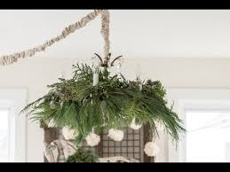 Live Greenery Christmas Decorations by How To Decorate A Chandelier With Fresh Greenery For Christmas
