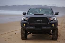 toyota trucks emblem grill with oem toyota emblem for mgm colored trucks and stock