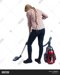 Vacuuming Rear View Of A Woman With A Vacuum Cleaner She Is Busy Cleaning