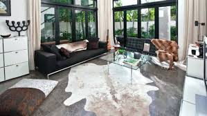 faux cowhide rug cowhides layered over natural fiber rugs buy a