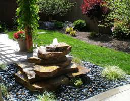 garden with bamboo plants and stone fountain wonderful stone