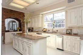 kitchen travertine backsplash staggering cotta tile kitchen bricks white cabinets traditional