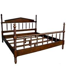 custom walnut wood bobbin bed with turned spindle head and foot