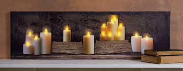 radiance flickering light canvas radiance lighted small canvas mantle of candles and old books with