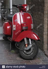 scooter vespa piaggio parked in stock photos u0026 scooter vespa