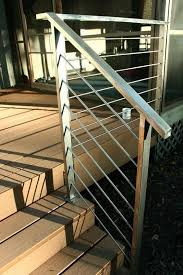 simple stainless steel deck rails add a modern touch to outdoor