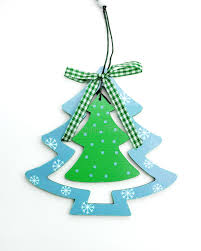 Wooden Toy Christmas Tree Decorations - blue wooden toy christmas tree on a white background stock photo