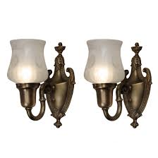 pair of antique adam style sconces with original shades
