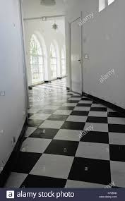 art deco flooring white art deco hall with black and white floor tiles stock photo