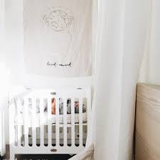 Alma Bloom Mini Crib Bloom Alma Mini Crib In White In A Fresh White Nursery From