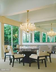 Dining Room Crystal Chandelier by Round Dining Table Under Crystal Chandelier Stock Photo Getty Images